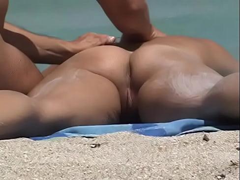 Nude Beach Voyeur Video - Hot Girl Gets Naked Ass Massage On The Beach!