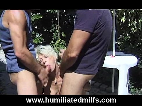 Blonde MILF Eva Delage sucks two dicks outdoors