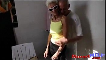 skinny eager rich lady with a thin silhouette is playing with a few guys