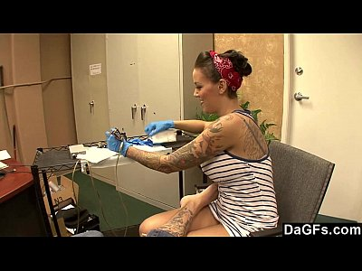 Beautiful tattoo artist satisfying a lucky